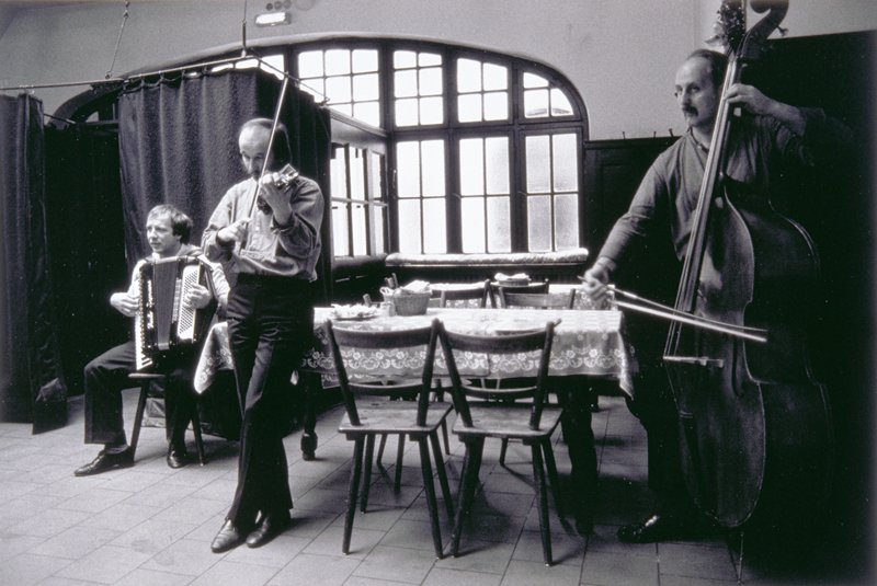 three musicians in cafe