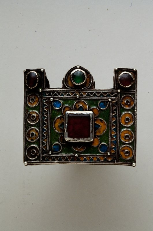 Amulet, 1868 metal, blue, green, and yellow enamel; red and green glass