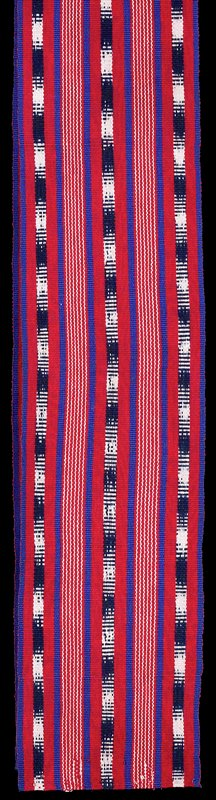 a. trousers-white ground with black ikat stripes and discontinuous supplementary weft patterning in red, pink, green, purple, and orange; 40 1/4 X 25 1/4 inches at waist; b. sash-red ground with ikat and royal blue stripes; 79 X 8 5/8 inches. Surface ornamentation (Dyed)