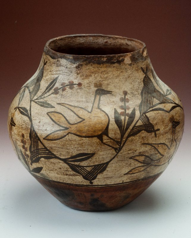 Predominately white vessel with red bottom. Detail of yellow birds on black branches with red berries.