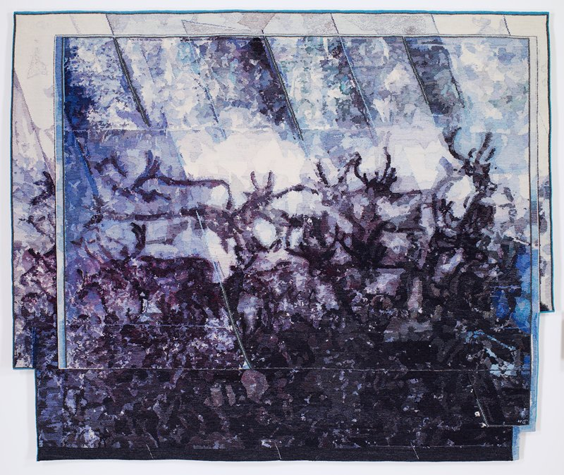 high warp tapestry in cream and shades of blues and purple depicting a herd of caribou