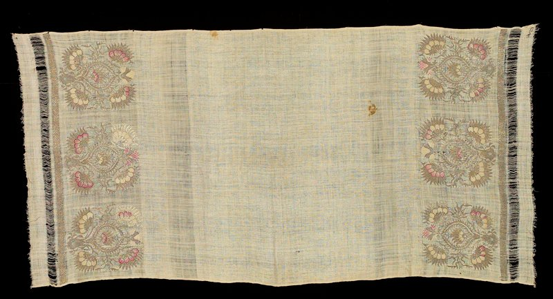 ecru woven fabric with stylized flowers and motifs in ecru, rose, blue and metallic thread