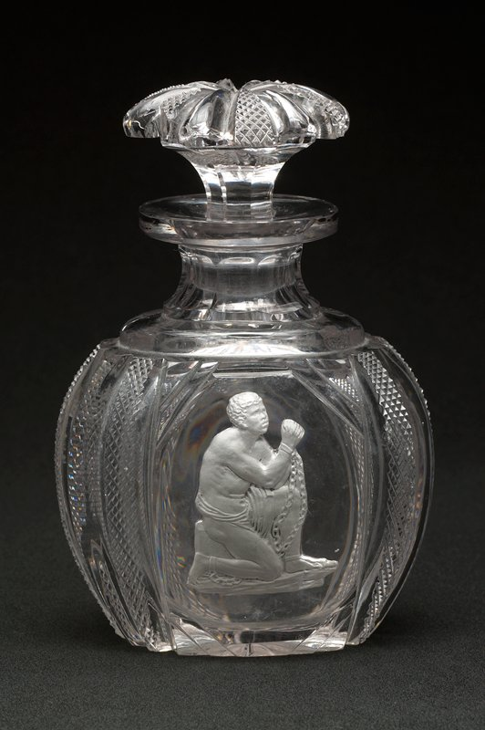 clear glass; pillar cut with diamonds cut in alternating ribs; starburst on bottom; cameo incrustation decoration of a kneeling supplicant slave in chains