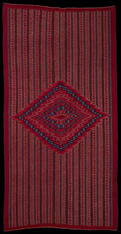 wool weft, cotton warp; border enclosing varigated background with central diamond motif; red, blue, yellow and white colors