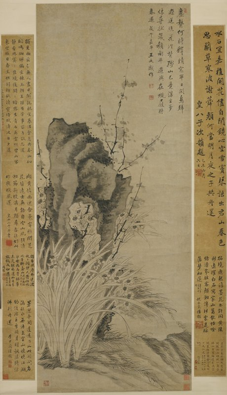 large rock with open area in center, surrounded by tall grasses, flowers and leafy branches; 2 fields of text on L and R on silk