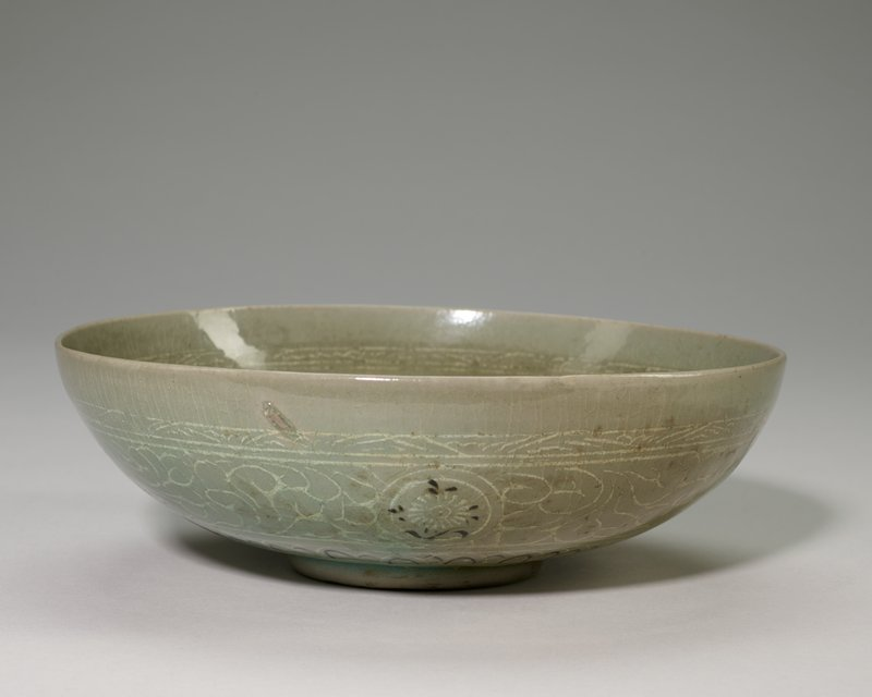 Bowl, celadon ware, shallow, with delicate decoration inside and out. (Mishima decoration) Three marks under base.