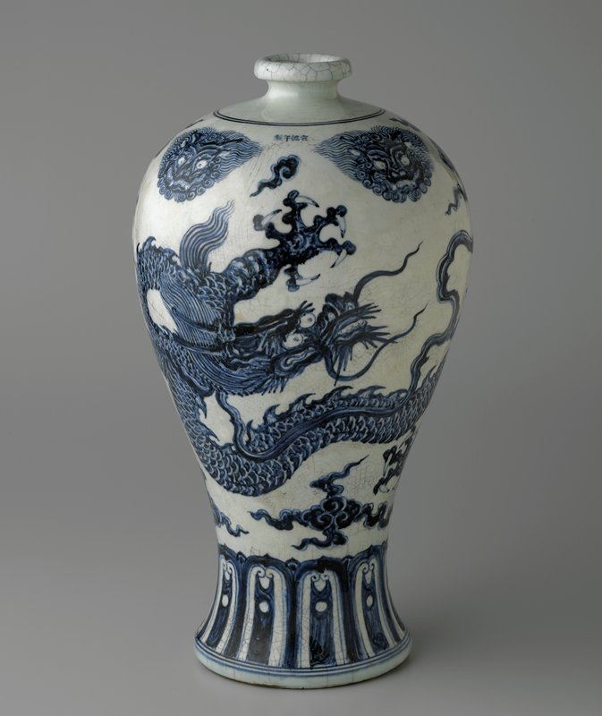 large blue and white glazed jar with dragon and 4 fantastic heads; wide foot and shoulder; narrow reel mouth