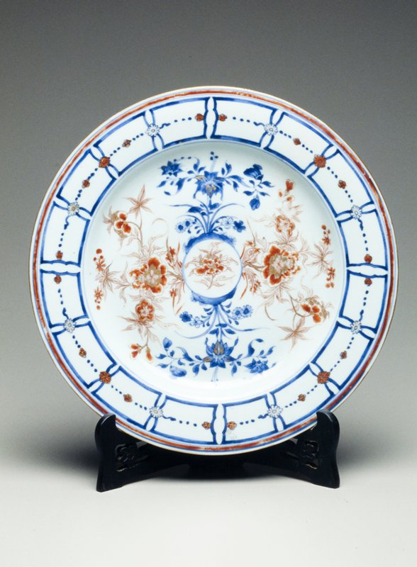 Chinese Export Imari dish; center gilt-heightened iron-red peony sprays- underglaze blue rim with paneled border, divided by gilt and iron-red blossoms, iron-red band