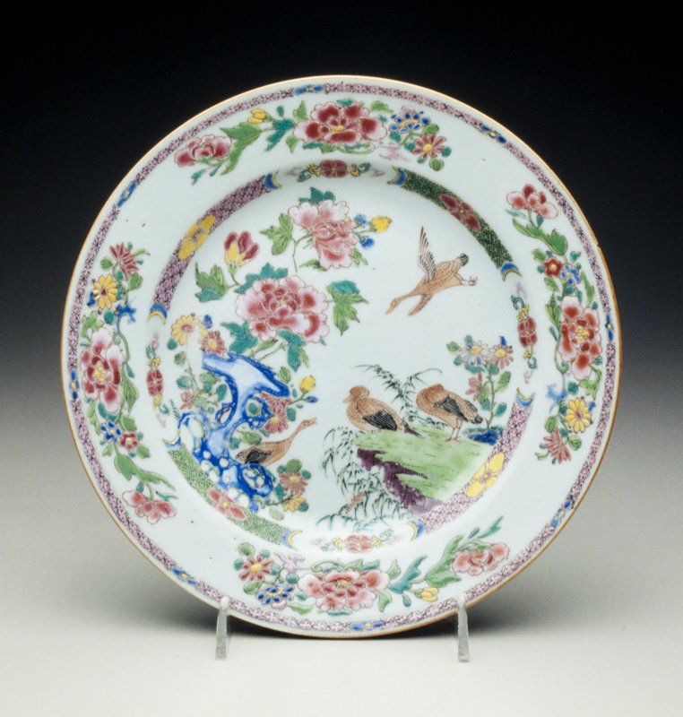 porcelain famille rose plate pair of ducks and two geese in flight, birds standing on rockwork, border with peony and flowering plants