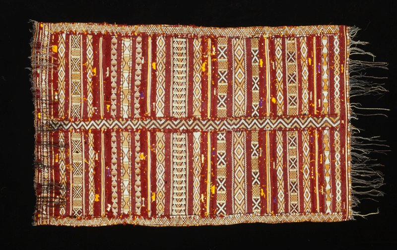 red ground; central and side stripes border two areas of banding; geometric patterning; DSWP of silk bands and tassels