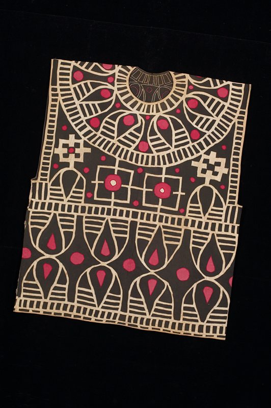 applique embroidery; black ground with white and red applique patterning. Surface ornamentation (Needlework)
