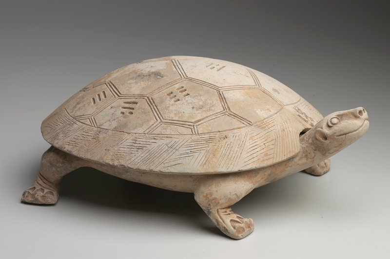 ink tablet, form of tortoise with cover, standing on its four feet; cover decorated with incised designs of scales with the Pa Kwa; inscribed with the eight trigrams of the 'Yi-Ching' (The Book of Changes), representing the various forms of change, principles or laws of the universe
