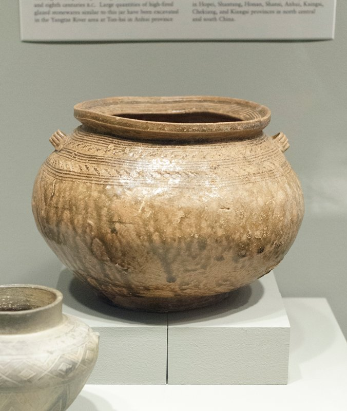 Beaker, Tsun, decorated with three bands of geometrical incised designs. The middles band, with feather design, has three protruding bosses regularly spaced; the lower band, with simple design of horizontal lines, also has three protruding bosses. The base, with slightly flared bottom, is decorated with incised lines. Polished surface, no glaze.