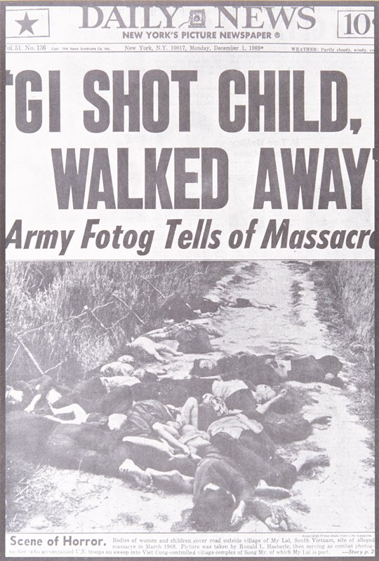 newspaper photograph of bodies covering a road
