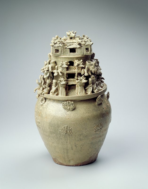 jar-shaped understructure; above shoulder divided into three tiers upper walled-in structure, middle birds, jars and seated figures at center of side, lower seated figures engaged in activity; two gates flank opposite sides; two bands of applied dragon designs to main unadorned body; green glaze