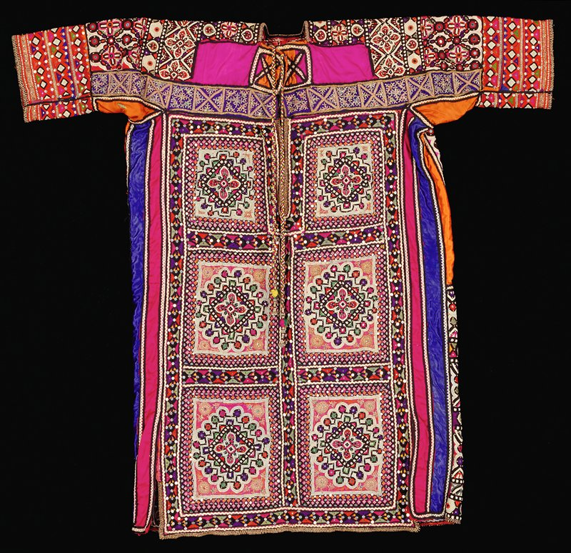 Shirt with long neck opening with multicolored braided tassels with buttons on ends; allover multicolored embroidery with six bordered blocks with geometric motif on front and allover organic and geometric designs on back; sequins and shiny metal disks encorporated throughout design SO / EMB
