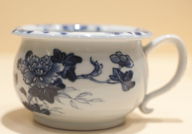 Chinese Export blue and white porcelain; painted with rose branches and flower sprays; loop handle