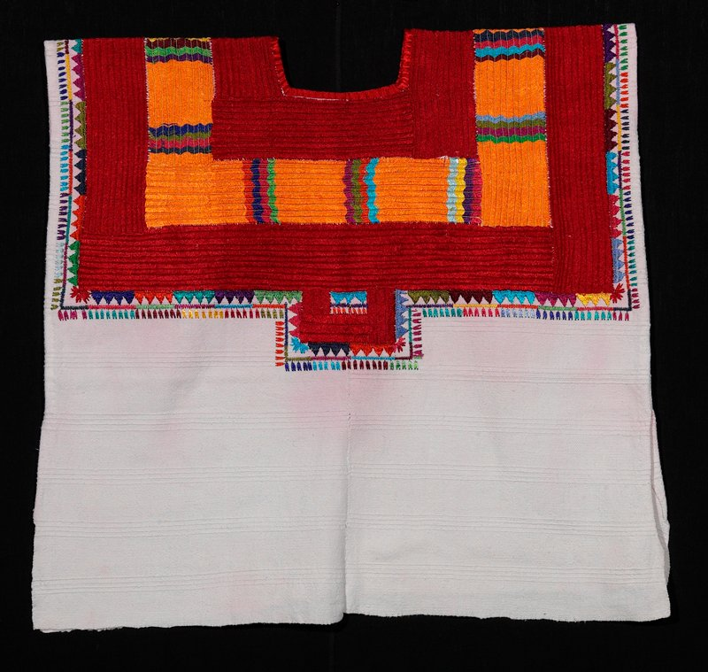 square two-paneled huipil with wide-looped rayon stitch embroidery; white background, red, orange, blue
