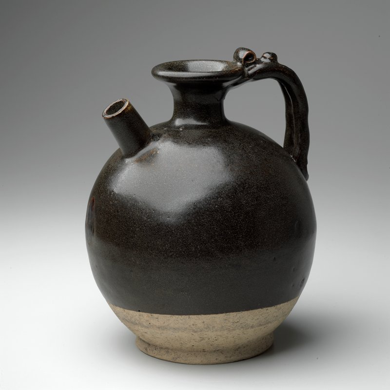 bulbous stoneware pot with handle, small opening at top, small spout on side; greenish brown glaze does not go to bottom