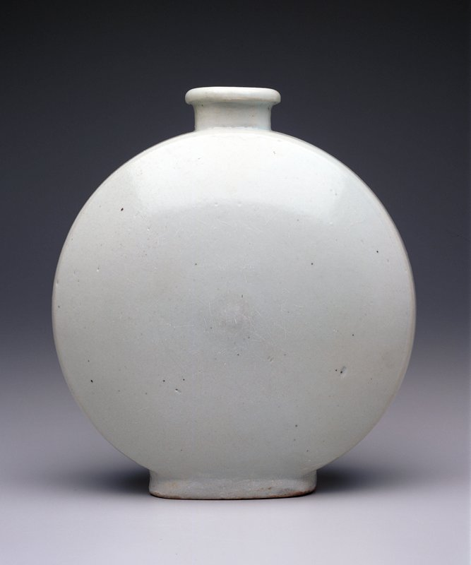 Flat, circular body; greenish white glaze; has lidded wood box