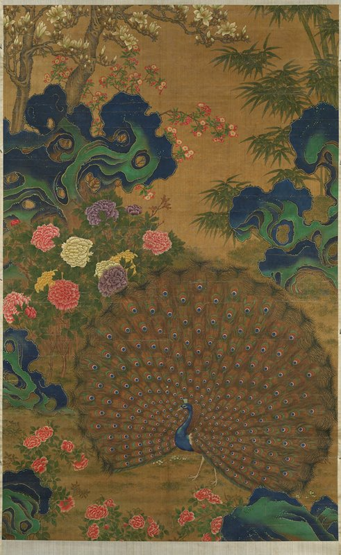 peacock with tailfeathers extended; blue and green rocks in strange shapes; pink flowers on bottom; white, purple, yellow and pink flowers at left center; pink and white flowers in ULC