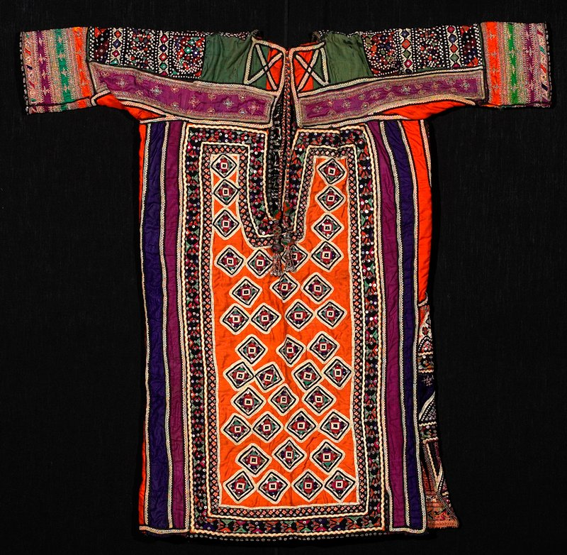 front: all-over embroidery with pink, black, purple, ecru, yellow, green, orange, red, metallic; sequins and mirrors embroidered into patterns; back: central orange panel with diamond embroidered patterns, surrounded by borders of embroidery, rickrack, sequins and lace; tassels at neck