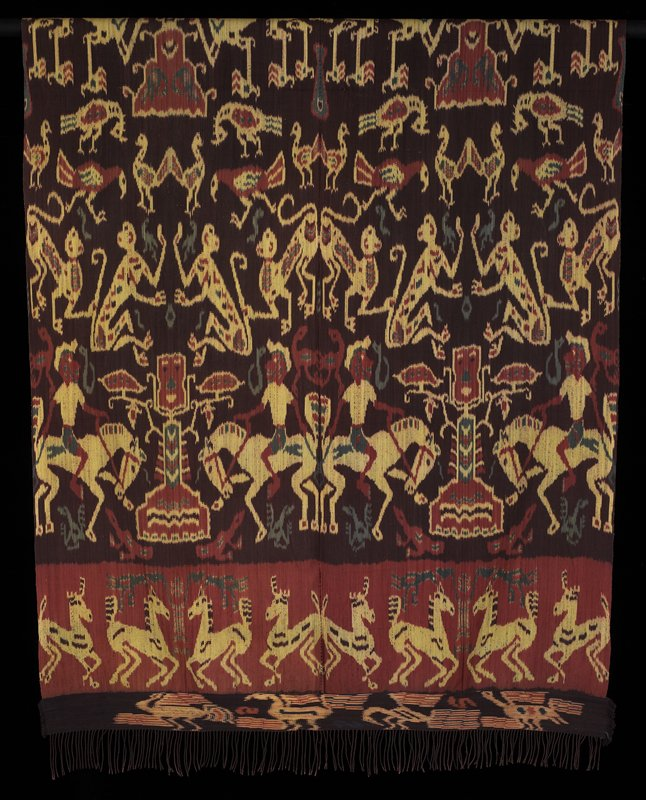 backstrap loom woven; brown ground; horses with riders, deer, monkeys, birds, lions and moths in tan, rust, turquoise and blue