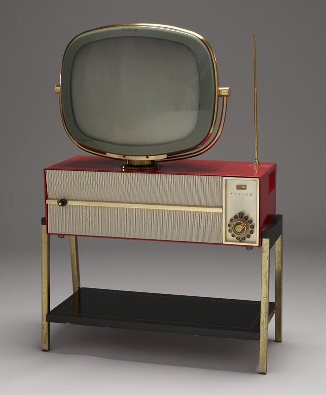 swivel TV picture tube with tan plastic backing attached to a red and white metal console on a stand with black plastic bottom shelf and chrome legs
