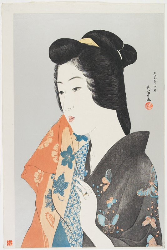 head and shoulders of a woman with her hair up, holding an orange and blue cloth with floral patterns; woman wears a black kimono with orange and blue butterflies and a gold ring with a blue stone