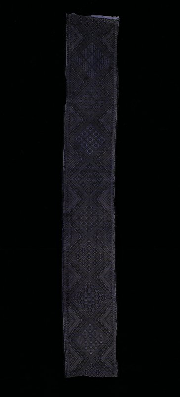 Black and purple discontinuous weft patterning with triangle and diamond designs.