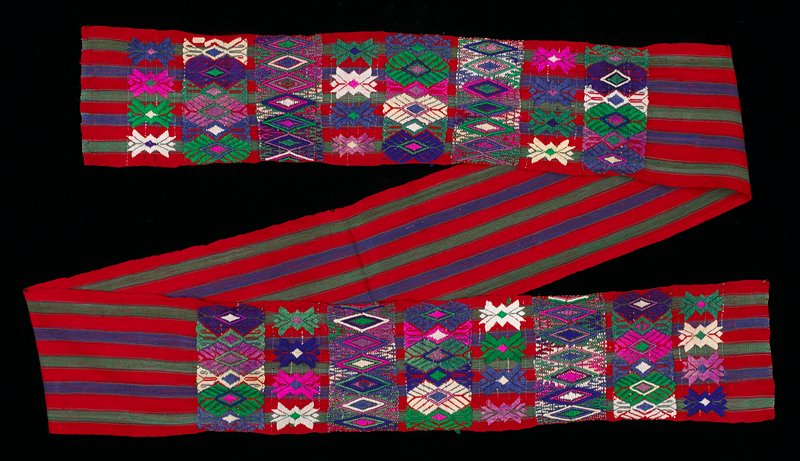Red background with green and blue stripes, supplementary weft patterns in big geometric designs; four selvedge