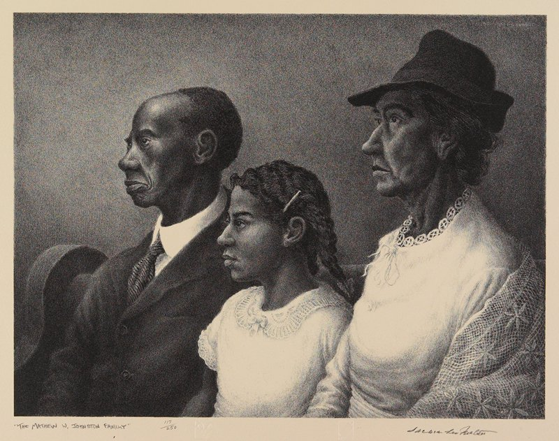 Black woman at right wearing a dark hat and a light dress and shawl; black girl at center with her hair in two braids, wearing a lace collar; balding black man at left, wearing a suit and tie