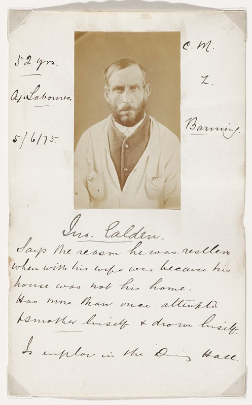 portrait of a man with deep-set eyes, dark beard and moustache, wearing a vest and a light colored jacket; photo glued to folded paper with various pen inscriptions