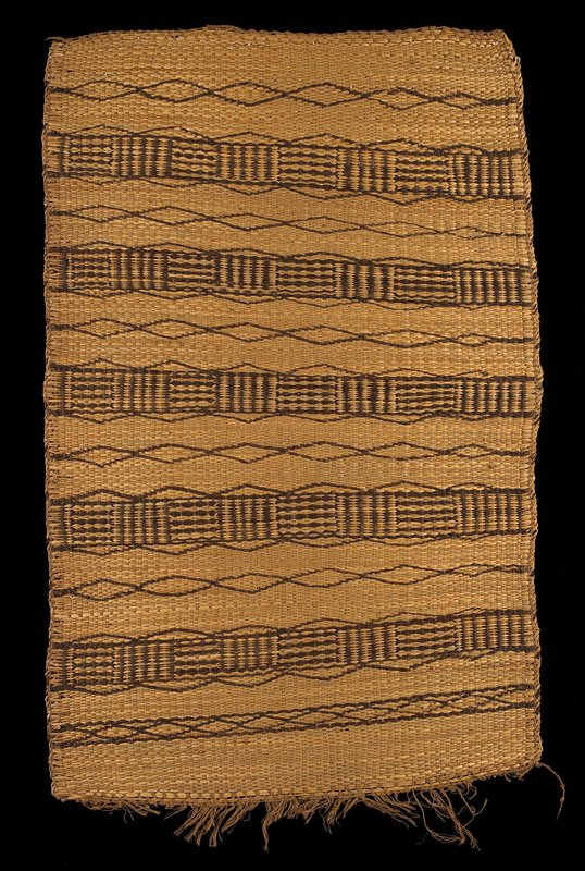 plant fiber woven mat; alternating diamond and geometric bands in dark brown on tan; fringe at one short end