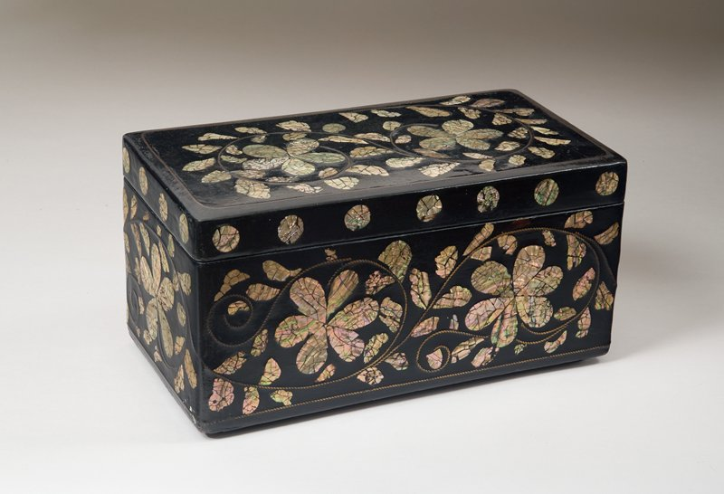 black lacquered box with mother-of-pearl inlaid flowers and vines; twisted wire design creating swirling tendrils; mother-of-pearl dots along outside edge of box