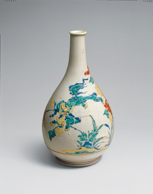 bottle with design of red and cream colored peonies, and a Chinese lion