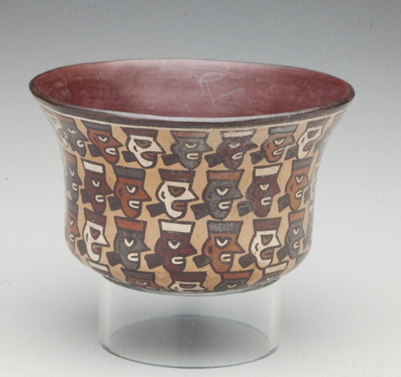 Cup with trophy heads; polychrome earthenware; Peru, Nazca, VIc.; No Dims on Cat. Cards Cup with slightly flaring mouth painted in polychrome with four rows of trophy heads.