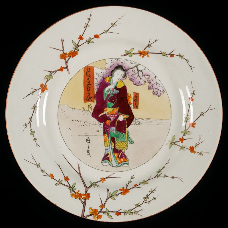 "creamware; orange line rim; shoulder decorated with plum blossoms; center painted with ""Ukiyo-e"" style woman in plum-colored kimono, holding a basket filled with foliage"