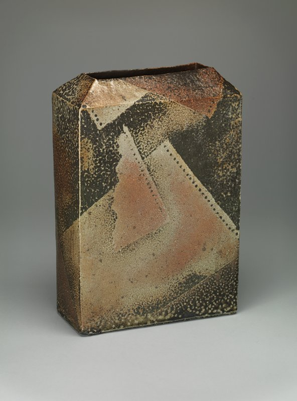 vertically orientated rectangular vase with beveled edge around mouth, and rectangular mouth; mottled dark background with overlapping geometric shapes resembling film strips; opalescent glaze; dark background, beige and pink forms