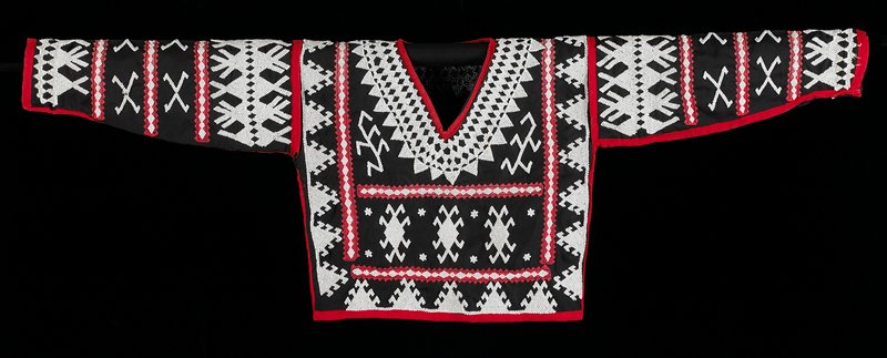 Background is black with red appliqué ribbon; overall front and back decorated with white beads.