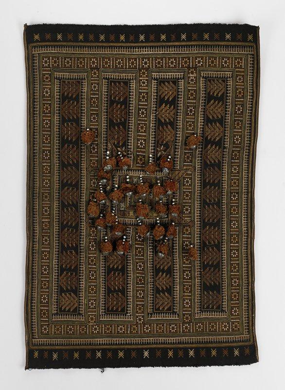 black background; embroidery in brown, ecru, ochre, green; 27 bells