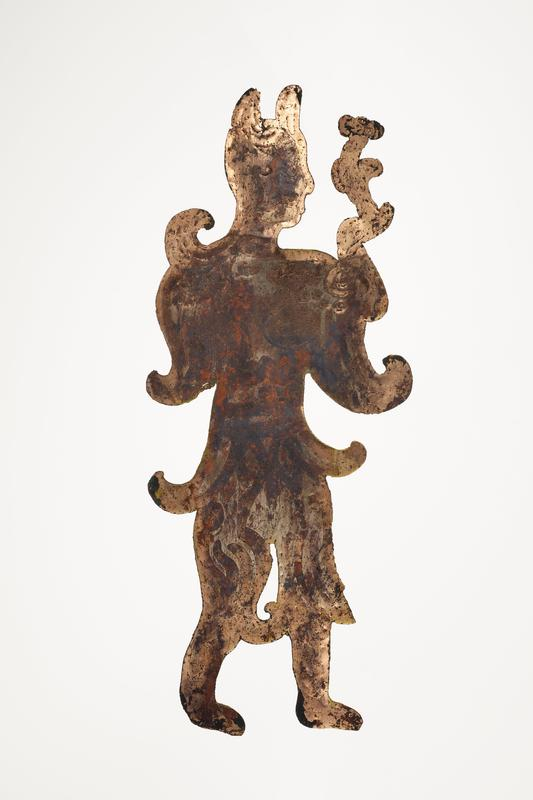 standing figure holding a flower-like object; facing R; incised details; mounted on black cloth-covered board with L2003.116.9.1