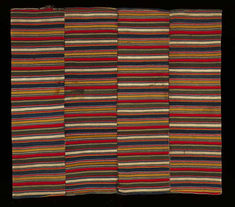 four panels joined to form skirt; alternating bands of varying colors red, yellow, blue, red, green, pink and white and varying band widths; panels not lined up to match pattern on each