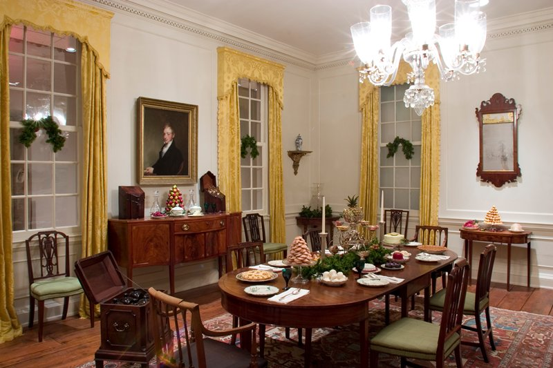 Dining Room from Colonel John Stuart's house at 104 Tradd Street, Charleston S.C. The paneling is of cypress wood painted white and the overmantle shows the influence of the classical tradition in America during the XVIII century. The house from which this room came was erected in 1772.