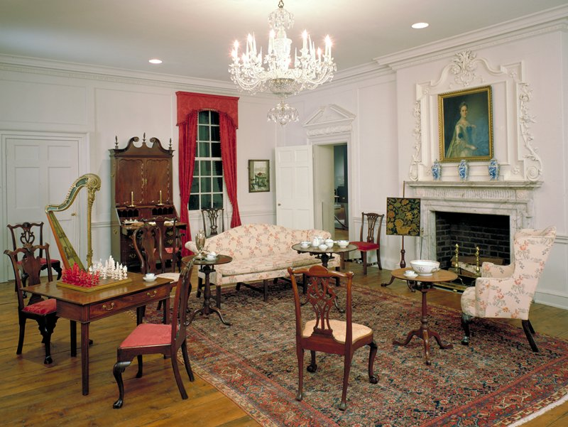 Woodwork from the interior of Colonel John Stuart's house at 104 Tradd Street, Charleston S.C. Cypress paneling from the drawing room showing doorways and fireplace with elaborate overmantle, showing French influence. The house was built in 1772.