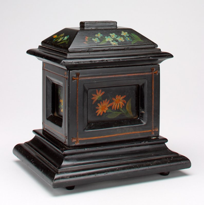 black slate money box painted with forget-me-nots, daisies and violas; coin slot at the top; 4 little feet on bottom