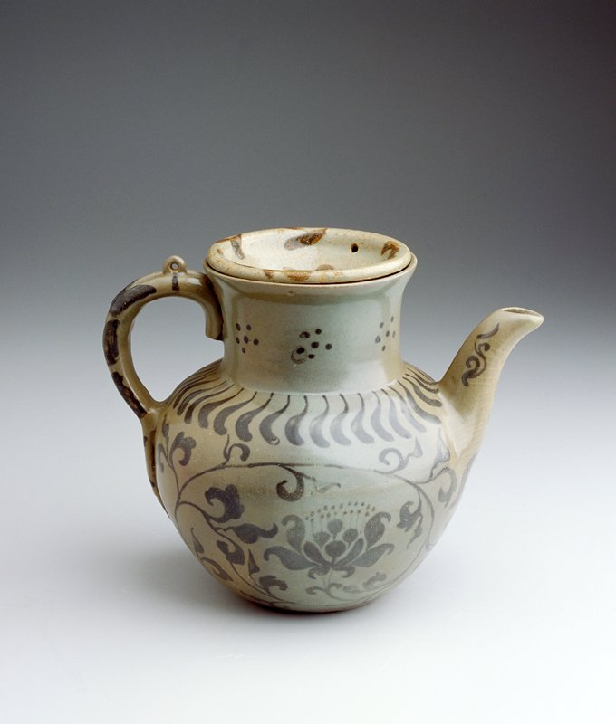 pitcher form with pulled handle and spout; wide mouth; plate-shaped lid; glazed grey overall with underglaze iron floral patterns in brown