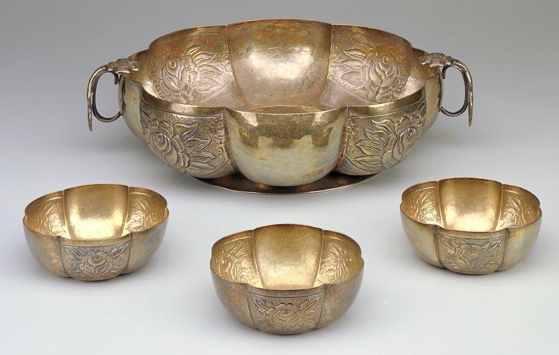 Bowl with six hammered lobes; alternating lobes have impressed floral design