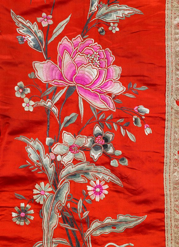 red with pink waistband; embroidered with small flowers on side panels and large floral sprays at center front and center back; lace trim