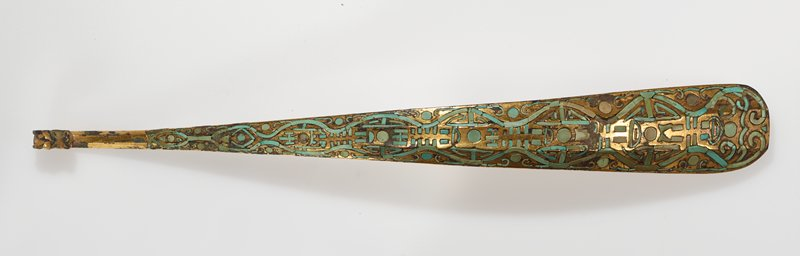 A bovine head in the round decorates this dress hook of gilded bronze inlaid with turquoise in an abstract design. It is a first rate exmple of a well-known type. For a similar dress hook, see Eumorfopoulos, Volume 2, Plate 40.